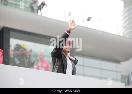 British Formula One driver Lewis Hamilton of Mercedes waves to fans before the Starting Grid of the Formula 1 Heineken Chinese Grand Prix 2019 at the - Stock Photo