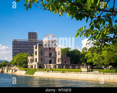 The Hiroshima Peace Memorial (Genbaku Dome, Atomic Bomb Dome or A-Bomb Dome) and the Ota River in Hiroshima, Japan. - Stock Photo