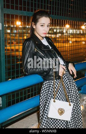 --FILE--In this handout picture, Chinese Uigur actress Dilraba Dilmurat, also known as Dilireba, arrives at the Shanghai Pudong International Airport - Stock Photo