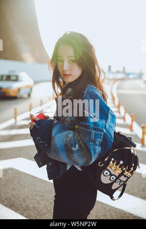 --FILE--In this handout picture, Chinese Uigur actress Dilraba Dilmurat, also known as Dilireba, arrives at the Beijing Capital International Airport - Stock Photo