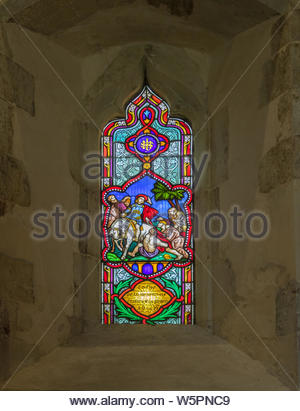 Interior of St. Mary's Church Hartley Wintney, Hampshire UK. Picture shows a stained glass window erected in memory of Charles Felix Palmer who died o - Stock Photo