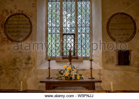 Interior of St. Mary's Church Hartley Wintney, Hampshire UK. Picture shows the eastern window, altar and communion rail and wall painting remnants. - Stock Photo