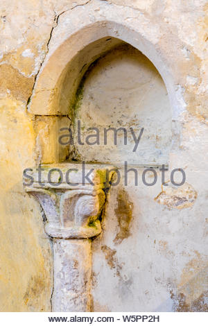 Interior of St. Mary's Church Hartley Wintney, Hampshire UK. Picture shows the 12th century Piscina used to was the Communion Vessels. - Stock Photo