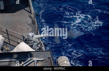 ATLANTIC OCEAN (July 26, 2019) — The Arleigh Burke-class guided-missile destroyer USS Porter (DDG 78) fires a Mark 46 30-millimeter gun during a live-fire exercise in the Atlantic Ocean July 26, 2019. Porter, forward-deployed to Rota, Spain, is on its seventh patrol in the U.S. 6th Fleet area operations in support of U.S. national security interests in Europe and Africa. (U.S. Navy photo by Mass Communication Specialist 3rd Class T. Logan Keown/Released) - Stock Photo