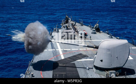The Arleigh Burke-class guided-missile destroyer USS Porter (DDG 78) fires a Mark 45 5-inch gun during a live-fire exercise in the Atlantic Ocean, July 26, 2019. Porter, forward-deployed to Rota, Spain, is on its seventh patrol in the U.S. 6th Fleet area operations in support of U.S. national security interests in Europe and Africa. (U.S. Navy photo by Mass Communication Specialist 3rd Class T. Logan Keown) - Stock Photo