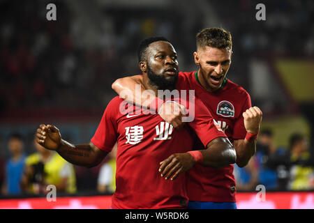 Cameroonian football player Franck Ohandza, left, of Henan Jianye celebrates with Brazilian football player Olivio da Rosa, also known as Ivo, after s - Stock Photo