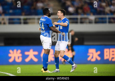 Cameroonian football player Franck Ohandza, left, of Henan Jianye celebrates with English-born Taiwanese football player Tim Chow after scoring agains - Stock Photo