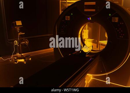 CT (Computed tomography) scanner in hospital laboratory. exam medical room scan. CMYK advertising banner. Health insurance concept, free medicine - Stock Photo