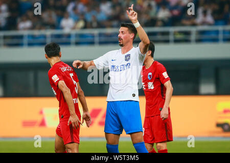 German football player Sandro Wagner of Tianjin TEDA reacts as he competes against Tianjin Tianhai in their 20th round match during the 2019 Chinese Football Association Super League (CSL) in Tianjin, China, 28 July 2019. Tianjin Tianhai defeated Beijing Renhe 1-0. - Stock Photo