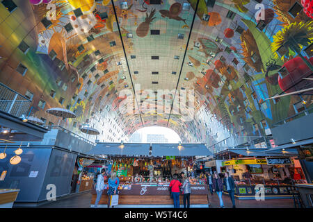 Rotterdam, Netherlands - May 13, 2019: The Markthal is a residential and office building with a market hall underneath, located in Rotterdam, Netherla - Stock Photo