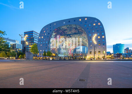 Rotterdam, Netherlands - May 13, 2019: The Markthal at night in Rotterdam city, Netherlands. - Stock Photo
