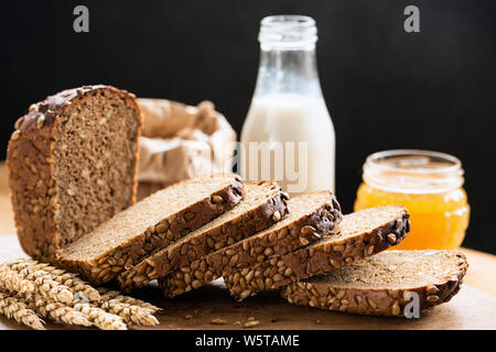 Rye bread with sunflower seeds sliced. Delicious fresh bread, rustic food still life - Stock Photo