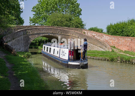 Narrowboat Muriel Grace approaching Turnover Bridge number 47 on the Grand Union canal, Blisworth Arm, Northamptonshire, UK - Stock Photo