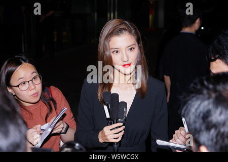 Hong Kong actress and model Karena Ng arrives for the wedding ceremony of singer and actress Gillian Chung and her husband doctor Michael Lai in Hong - Stock Photo