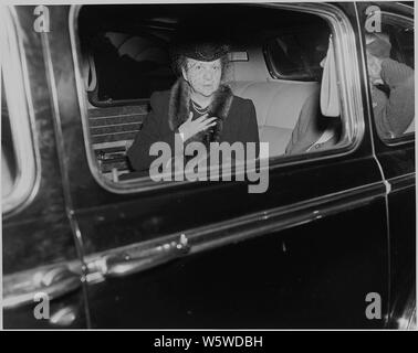 Photograph of Secretary of Labor Frances Perkins in an automobile, apparently at the White House shortly after President Roosevelt's death. - Stock Photo