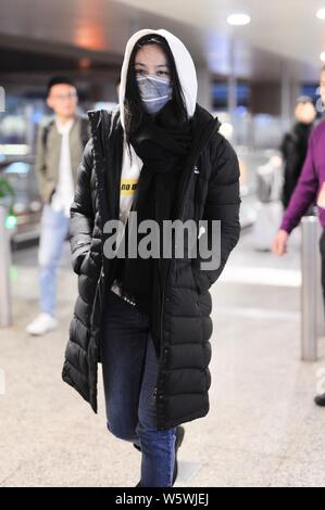 Chinese actress Tang Wei arrives at an airport in Shanghai, China, 26 December 2018. - Stock Photo