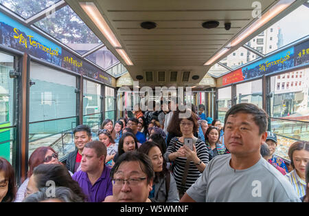 Passengers on a crowded Peak Tram, Victoria Peak, Hong Kong Island, Hong Kong, China - Stock Photo