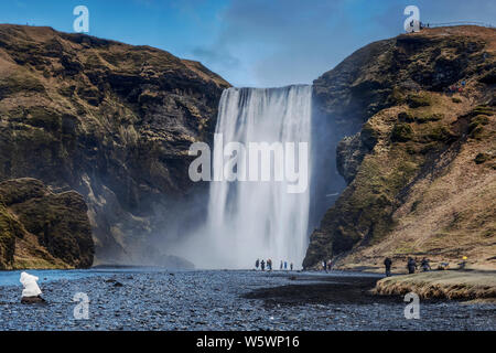 Skogafoss waterfall situated on the Skogo River in the south of Iceland at the cliffs of the former coastline - Stock Photo