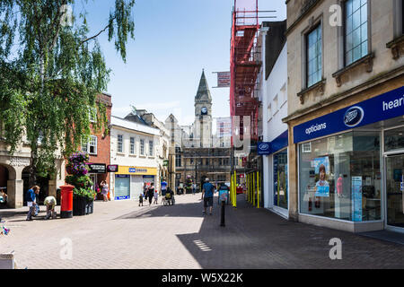 Fore Street Trowbridge, Wiltshire, going towards the town hall on a summers day. Scaffolding on the town hall and also on the right of Fore street. - Stock Photo