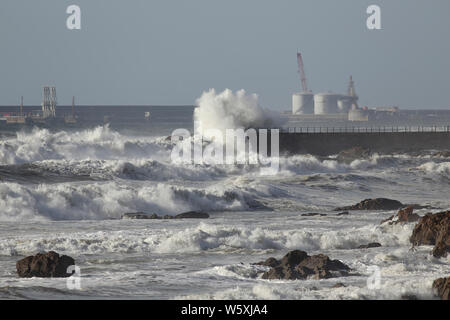 South wall and entry of Leixoes harbor in a rough sea day, Oporto, Portugal - Stock Photo