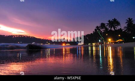 Colorful Mirissa beach at dusk, Sri Lanka. - Stock Photo