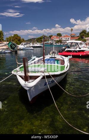 Small boats moored at Razanj harbour on the Adriatic coast of Croatia - Stock Photo