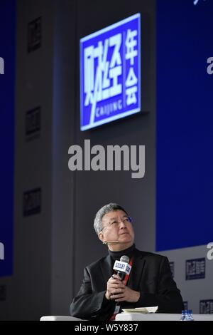 Former IMF Deputy Managing Director Zhu Min attends the CAIJING Annual Conference 2019: Forecasts and Strategies in Beijing, China, 13 November 2018. - Stock Photo