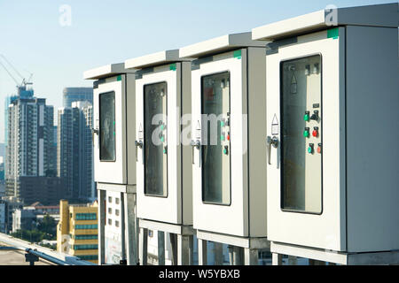 electric box control at the building rooftop with blur building background. - Stock Photo