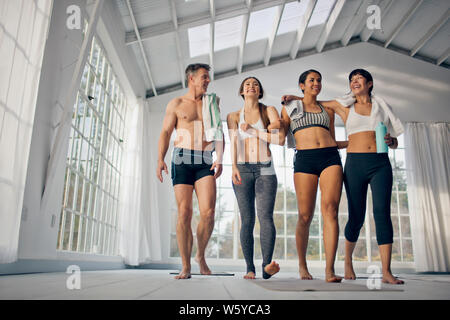 Group of friends laughing and smiling after an exercise class. - Stock Photo