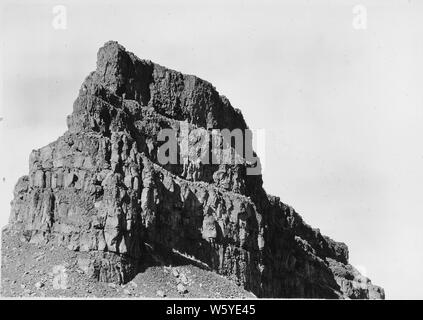 Typical rim-rock formation in Grand Coulee. Some 20 distinct lava flows are traceable in the cliffs of basalt which mark the gorge.; Scope and content:  Photograph from Volume Two of a series of photo albums documenting the construction of the Grand Coulee Dam and related work on the Columbia Basin Project. - Stock Photo