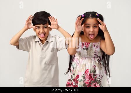 Two children making funny faces - Stock Photo