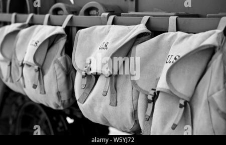 U.S Army bags on a 1940s American armoured personnel carrier M3 half-track - Stock Photo