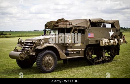 1940s WWII U.S Army armoured personnel carrier M3 half-track at Shuttleworth Military Airshow on the 7th July 2019 - Stock Photo