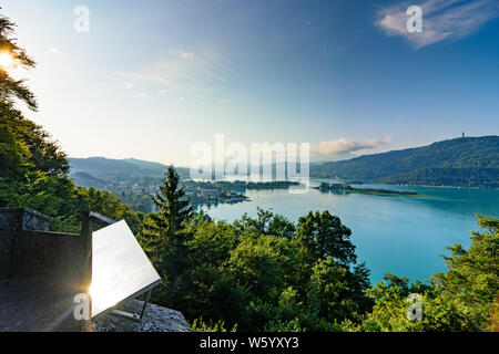 Pörtschach am Wörther See: lake Wörthersee, view from Hohe Gloriette to Pörtschach, Maria Wörth, observation tower Pyramidenkogel, mountain Karawanken - Stock Photo