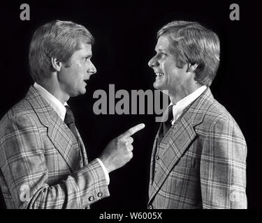 1970s BLOND MAN IN LOUD PLAID SUIT AND TIE TALKING TO POINTING AT INSTRUCTING LECTURING HIMSELF  - s20256 HAR001 HARS BLOND COMIC TEAMWORK TWIN COMPETITION INFORMATION EXPOSURE IDENTICAL DOUBLE PLEASED JOY LIFESTYLE STUDIO SHOT COPY SPACE HALF-LENGTH PERSONS INSPIRATION MATCH MALES PLAID EXPRESSIONS B&W BIZARRE MATCHING SAME SELLING WEIRD CHEERFUL AND GROTESQUE EXCITEMENT LOUD POWERFUL ZANY DIRECTION PRIDE UNCONVENTIONAL AT IN TO AUTHORITY OCCUPATIONS POLITICS SIBLING SMILES INSTRUCTING CONCEPTUAL HIMSELF JOYFUL STYLISH SUPPORT WACKY CONSCIENCE IDIOSYNCRATIC LOOK-ALIKE AMUSING DUPLICATE - Stock Photo