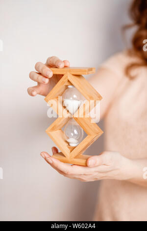 concept image of person holding hourglass. deadline and schedule concept.hourglass on hand, time countdown, clock with sand.time to pay the bills.Time - Stock Photo