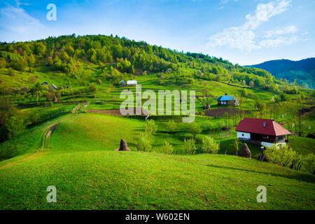 Peaceful life in Romania, small village landscape - Stock Photo