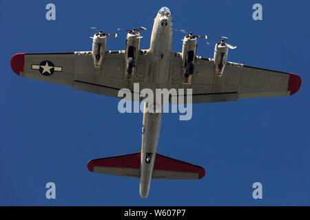 Low altitude pass of a Boeing B-17 Flying Fortress WWII bomber. - Stock Photo