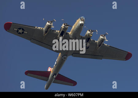Low altitude fly over by the B-17 Nine-O-Nine in Concord, CA. - Stock Photo
