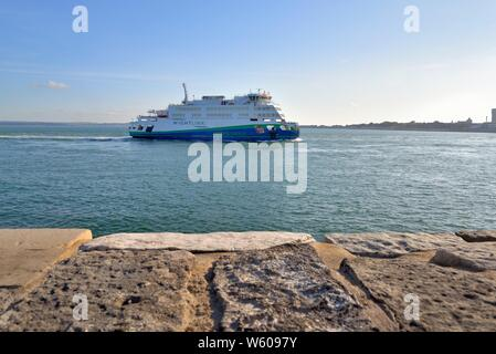 The Wightlink hybrid car and passenger ferry Victoria of Wight sailing into Portsmouth harbour on a summers evening, Hampshire England UK - Stock Photo
