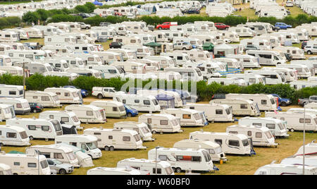 BUILTH WELLS, POWYS, WALES - JULY 2018: Rows of caravans parked in fields by people outside the Royal Welsh Show in mid Wales - Stock Photo