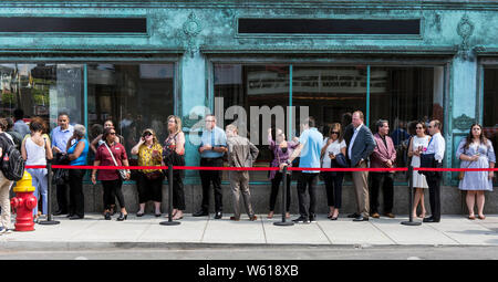 Detroit, Michigan, USA. 30th July, 2019. People line up to get into the first of two Democratic Debates in Detroit hosted by CNN and sanctioned by the DNC. Credit: Brian Cahn/ZUMA Wire/Alamy Live News - Stock Photo