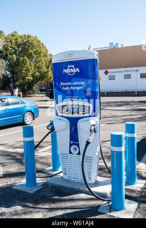 Electric Vehicle Fast Charge station with security bollards at Tamworth Australia. - Stock Photo