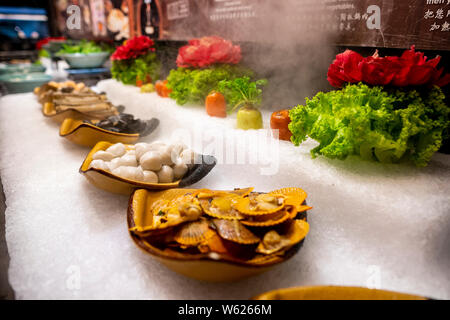 Delicious asian japanese style starter cold snacks sushi buffet table - Stock Photo