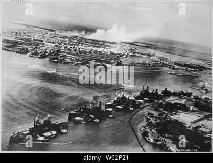 Captured Japanese photograph taken during the attack on Pearl Harbor, Dec. 7, 1941. In the distance, the smoke rises from Hickam Field.; General notes:  Use War and Conflict Number 1133 when ordering a reproduction or requesting information about this image. - Stock Photo