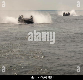 190726-N-GR168-2102 ATLANTIC OCEAN (July 26,2019) Two landing craft air cushion, assigned to Assault Craft Unit 4, transit in the Atlantic Ocean July 26, 2019.Warships assigned to the Bataan Amphibious Ready Group, including USS New York, are participating in the exercise in the Atlantic Ocean, off the coast of Virginia, to maintain readiness, proficiency and lethality.  (U.S. Navy photo by Mass Communication Specialist 2nd Class Lyle Wilkie/Released) - Stock Photo