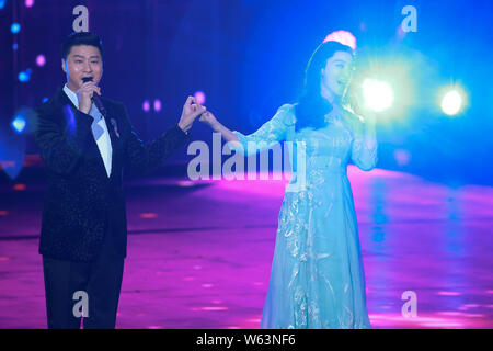 Chinese actress Fan Bingbing, right, and his father Fan Tao perform during a filming session for the Chinese New Year gala of Beijing TV (BTV) in Beij - Stock Photo