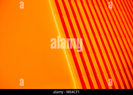 Orange background. plastic bag. Waste recycling concept. Environmental Protection. Polyethylene background texture.plastic containers stack . Concept