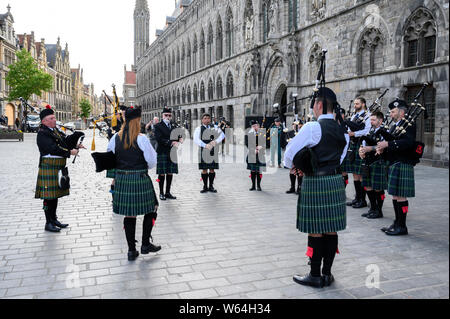 The Sons of Scotland Pipe Band of Ottawa rehearse outside the Cloth Hall, Ypres, Belgium prior to taking part in the Last Post Ceremony - Stock Photo