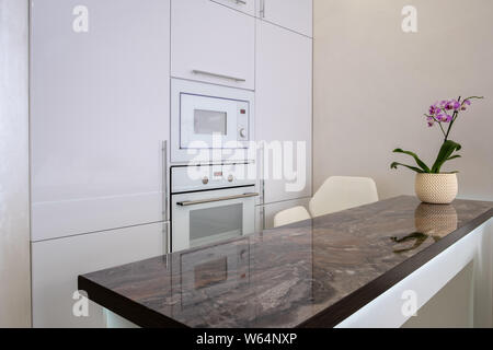 Footage of built in modules in kitchen, Interior shot. built-in microwave and oven. Interior of white modern kitchen - Stock Photo